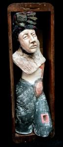 caryatid - rocks in (on) her head
